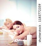 two young beautiful women... | Shutterstock . vector #1183772359