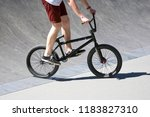 the urban cyclist in motion on... | Shutterstock . vector #1183827310