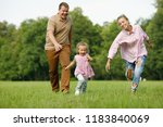 happy family in nature.... | Shutterstock . vector #1183840069