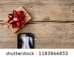 gift box with a red bow and... | Shutterstock . vector #1183866853