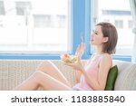 beauty woman eat salad and feel ... | Shutterstock . vector #1183885840