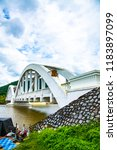 white bridge above mae tha...   Shutterstock . vector #1183897099