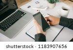 hands using smartphone at offie ...   Shutterstock . vector #1183907656
