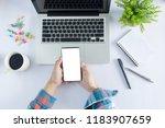 business concept.man holding a...   Shutterstock . vector #1183907659