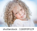 outdoor portrait of a smiling... | Shutterstock . vector #1183939129