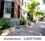 street and row of brownstones... | Shutterstock . vector #1183970080