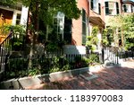 street and row of brownstones... | Shutterstock . vector #1183970083