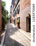 street and row of brownstones... | Shutterstock . vector #1183970089