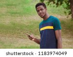 a black guy  a man standing in...   Shutterstock . vector #1183974049