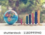 Small photo of World or global financial business growth or sales performance increase concept : Increasing height, color wood bar graph on a table, depicts an increase in product amount, extent, population size etc