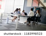 businesspeople discussing... | Shutterstock . vector #1183998523