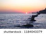 the sundown over the sea.... | Shutterstock . vector #1184043379