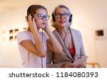 attentive tween girl with... | Shutterstock . vector #1184080393