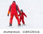 professional ski instructor is... | Shutterstock . vector #1184120116