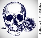 human skull with a rose in the... | Shutterstock .eps vector #1184130376