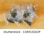 white tea leaves in transparent ... | Shutterstock . vector #1184132629