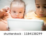 little boy and baby brother on... | Shutterstock . vector #1184138299