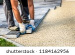 Laying Gray Concrete Paving...