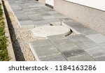 laying gray concrete paving... | Shutterstock . vector #1184163286