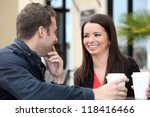 Young Couple Drinking Coffee...