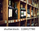 wine bottles on wooden shelf in ... | Shutterstock . vector #118417780