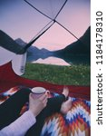 tourist woman sitting in tent... | Shutterstock . vector #1184178310