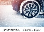 car tires on winter road... | Shutterstock . vector #1184181130