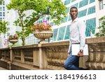 young african american graduate ...   Shutterstock . vector #1184196613
