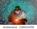welder worker welding process... | Shutterstock . vector #1184214550