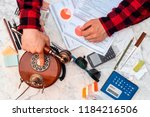 the businessman is thoroughly... | Shutterstock . vector #1184216506