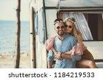 smiling hippie couple in... | Shutterstock . vector #1184219533