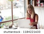 young blonde woman freelancer... | Shutterstock . vector #1184221633