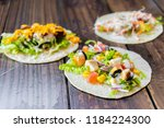 flour tortilla taco with... | Shutterstock . vector #1184224300