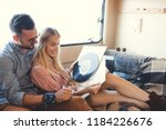beautiful hippie couple... | Shutterstock . vector #1184226676