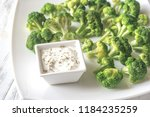 cooked broccoli with greek... | Shutterstock . vector #1184235259