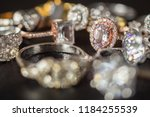 jewelry rings on black... | Shutterstock . vector #1184255539