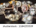 jewelry rings on black... | Shutterstock . vector #1184255539