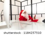 santa claus in the office... | Shutterstock . vector #1184257510