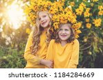 two joyful little girls with... | Shutterstock . vector #1184284669