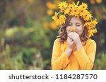 cute little girl with wreath of ... | Shutterstock . vector #1184287570