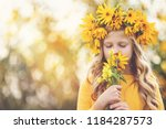 cute little girl with wreath of ... | Shutterstock . vector #1184287573