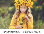 cute little girl with wreath of ... | Shutterstock . vector #1184287576