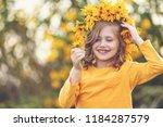 cute little girl with wreath of ... | Shutterstock . vector #1184287579
