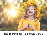 cute little girl with wreath of ... | Shutterstock . vector #1184287603