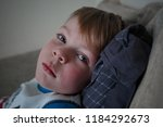 ailing sad little boy with... | Shutterstock . vector #1184292673