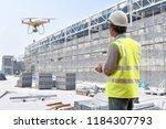 drone inspection. operator... | Shutterstock . vector #1184307793