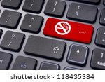a no smoking sign on keyboard enter key, to convey anti smoking concepts in workplaces or offices. - stock photo