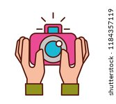 hands holding photographic... | Shutterstock .eps vector #1184357119