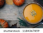 bowl of pumpkin soup on rustic... | Shutterstock . vector #1184367859