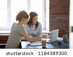 female colleagues working... | Shutterstock . vector #1184389300